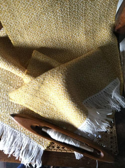 Mustard yellow goose eye twill woven in Shetland lambswool