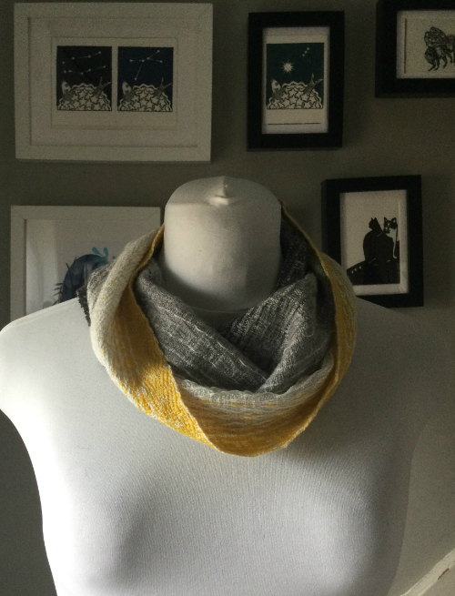 Hay Bale merino cowl in shades of yellow and grey on a mannequin