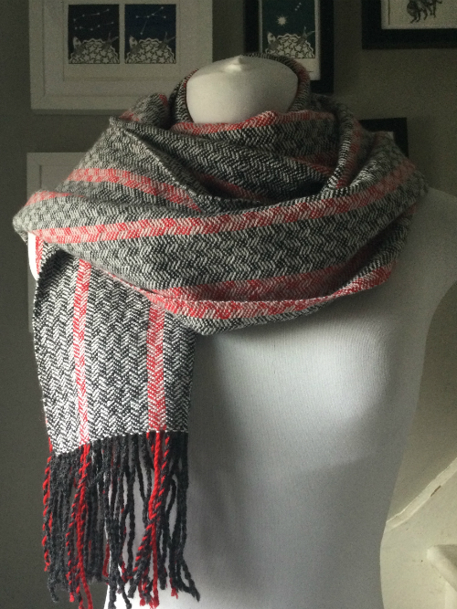 a handwoven merino and Shetland lambswool scarf in red, charcoal and silver